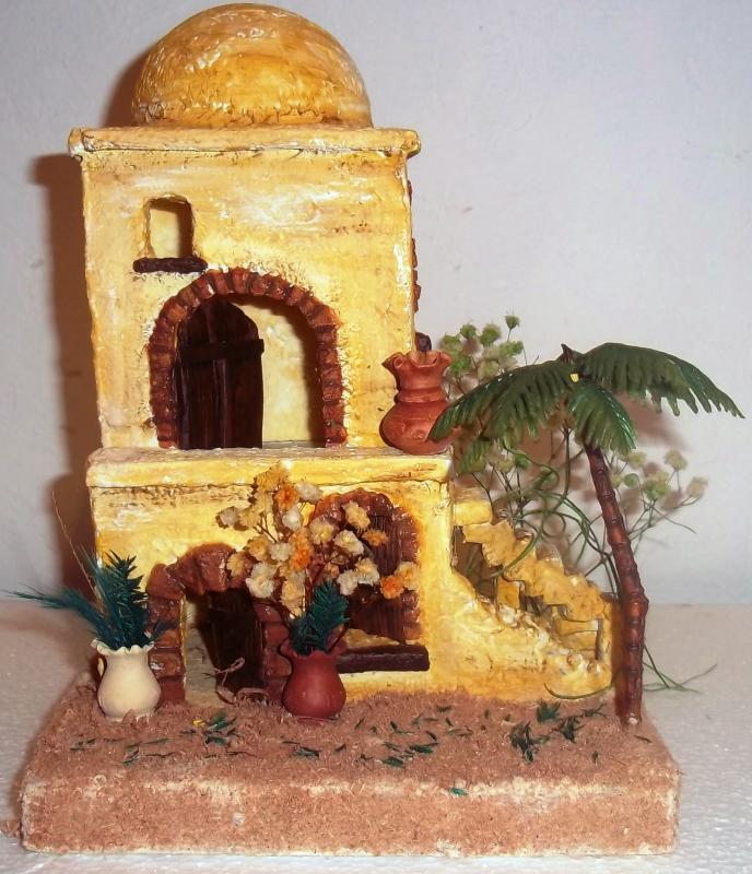 Casa dos plantas con gradas y palmera. Belén de Solarte Mauricio (El Tambo Cauca)