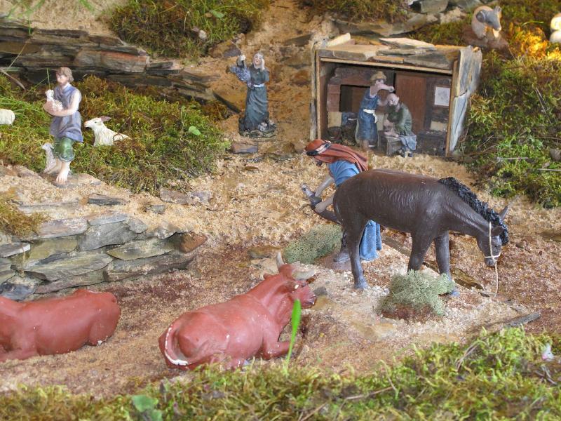 13- a ferrar o cavalo e a cortar o cabelo. Belén de Bombeiros Municipais Tavira (Tavira)