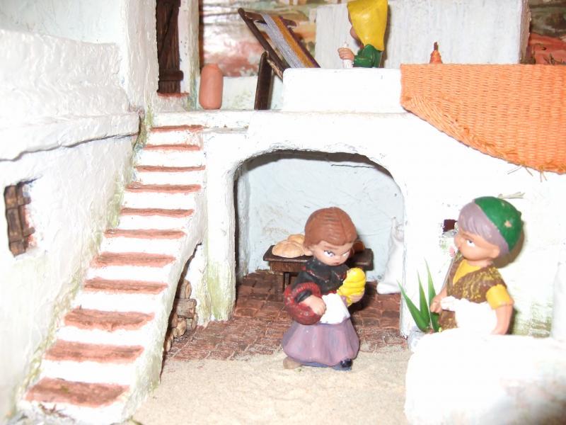 Paderia e tecedora. Belén de Associação Cultural Fusetense (Fuseta, Algarve)